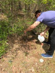 Jeremy's cemetery Jared planting rose bush April 2018